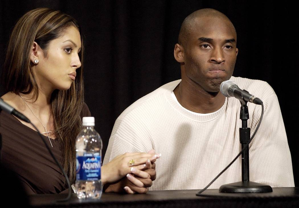 ** FILE ** Los Angeles Lakers' Kobe Bryant holds the hand of his wife Vanessa as he pauses duri ...