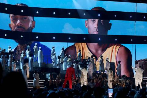 YG, from left, John Legend, Kirk Franklin, DJ Khaled and Meek Mill point to a screen showing Ni ...