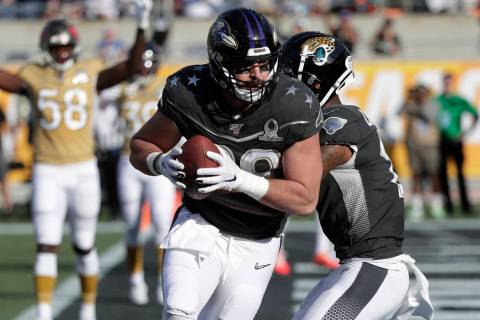 AFC tight end Mark Andrews, of the Baltimore Ravens, (89) scores a touchdown, during the first ...