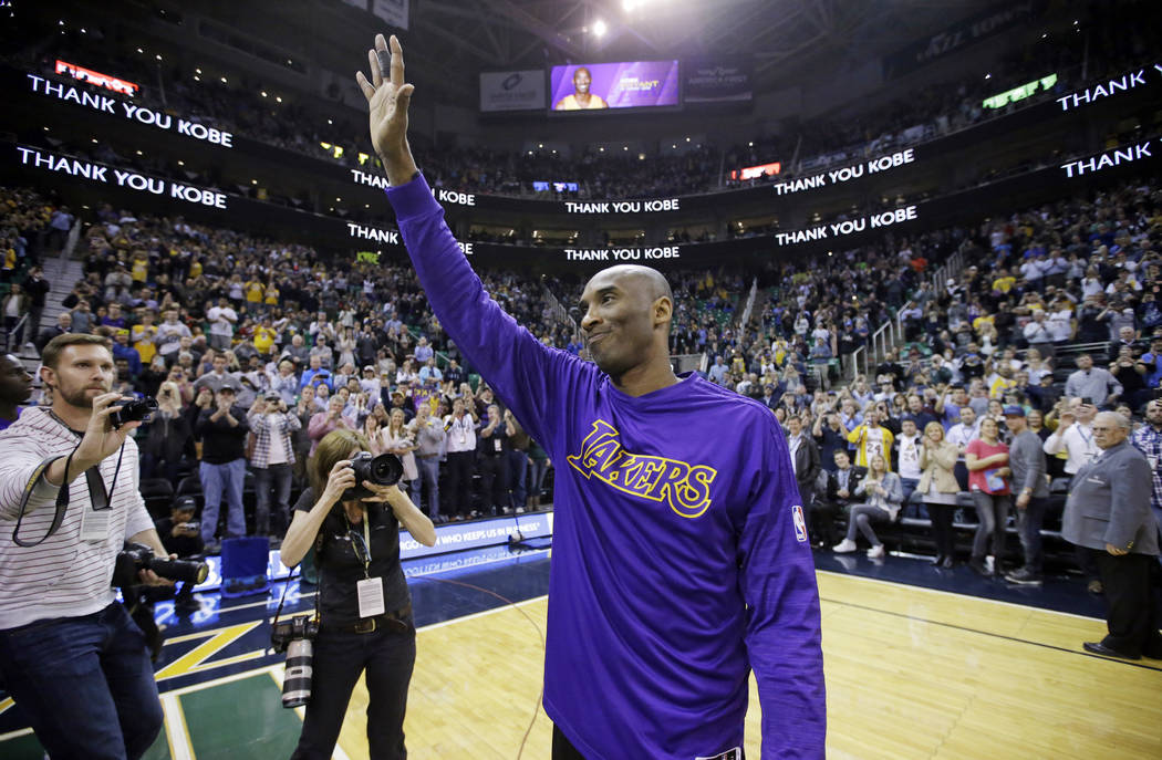 FILE - In this March 28, 2016, file photo, Los Angeles Lakers forward Kobe Bryant waves to the ...