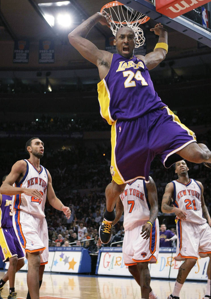 FILE - In this Feb. 2, 2009 file photo Los Angeles Lakers guard Kobe Bryant (24) reacts after a ...