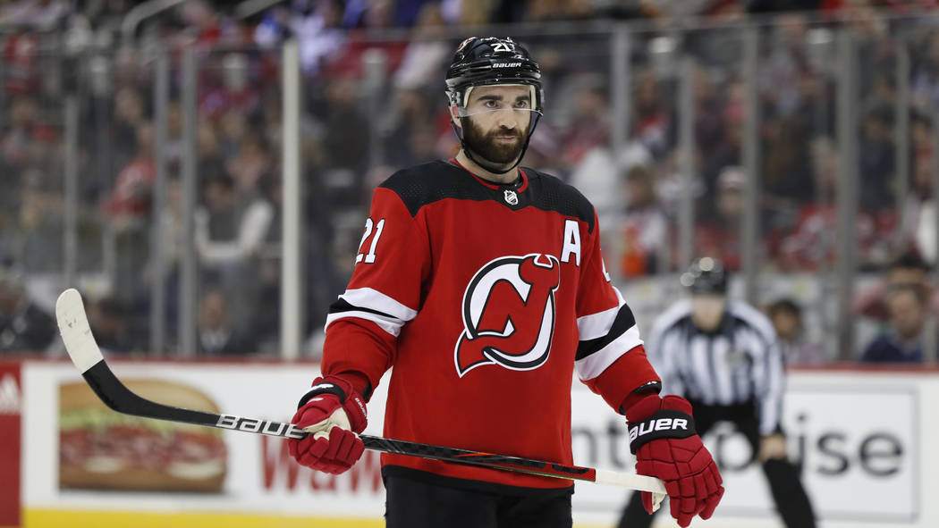 New Jersey Devils right wing Kyle Palmieri (21) before a face-off in the second period of an NH ...