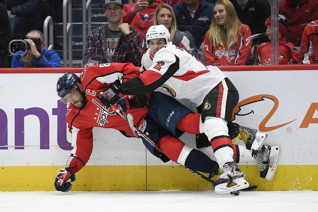 Ottawa Senators defenseman Dylan DeMelo (2) collides into Washington Capitals left wing Alex Ov ...