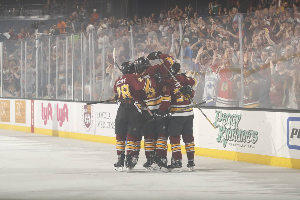 The Chicago Wolves celebrate a goal against the Charlotte Checker in the first period of Game 4 ...