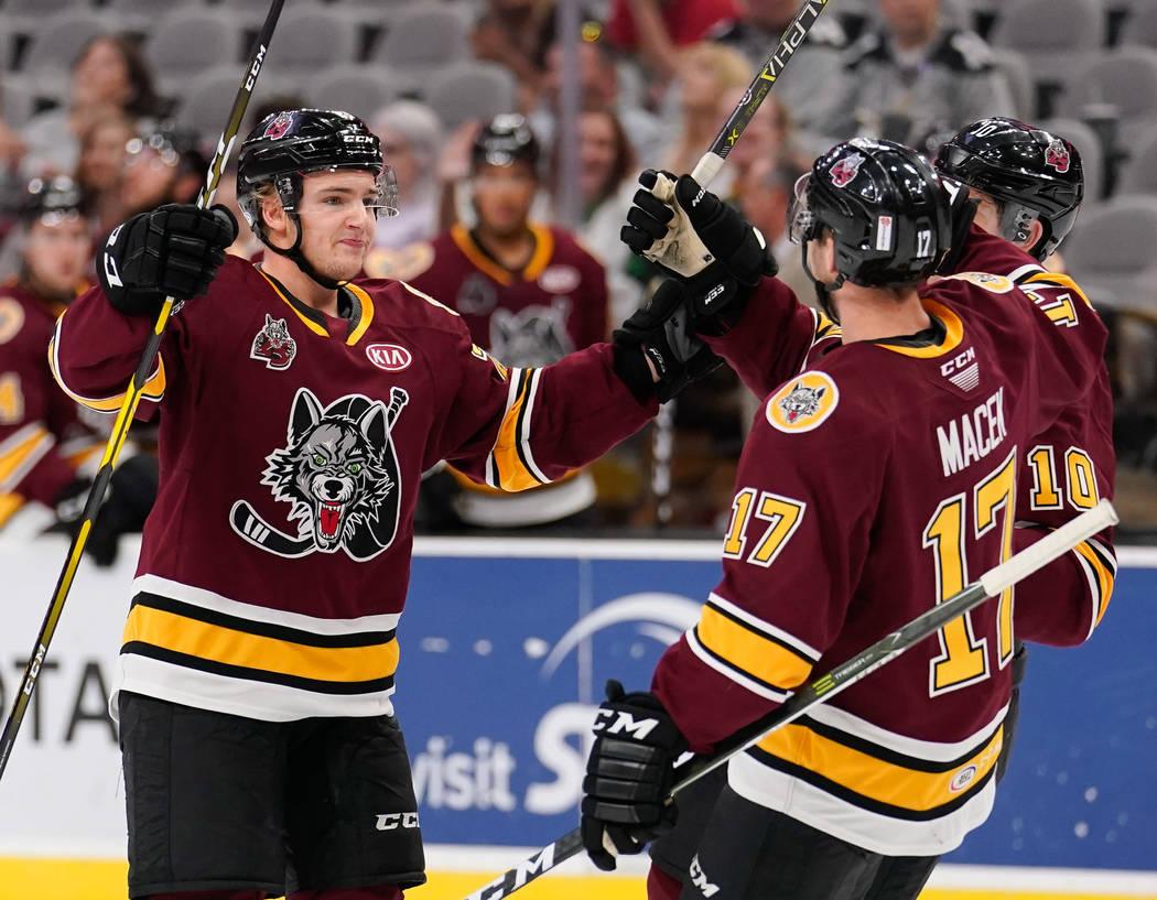 Chicago's Erik Brannstrom, left, celebrates a goal with teammate Brace Macek during an AHL game ...