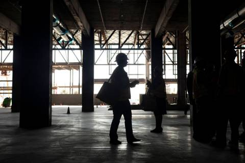 Individuals view the under construction Expo at World Market Center during a tour on Monday, Ja ...