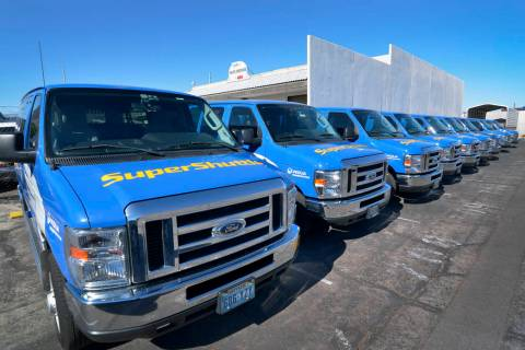 Some of the 15vehicles bought by SuperShuttle for its residential service are shown in the shut ...