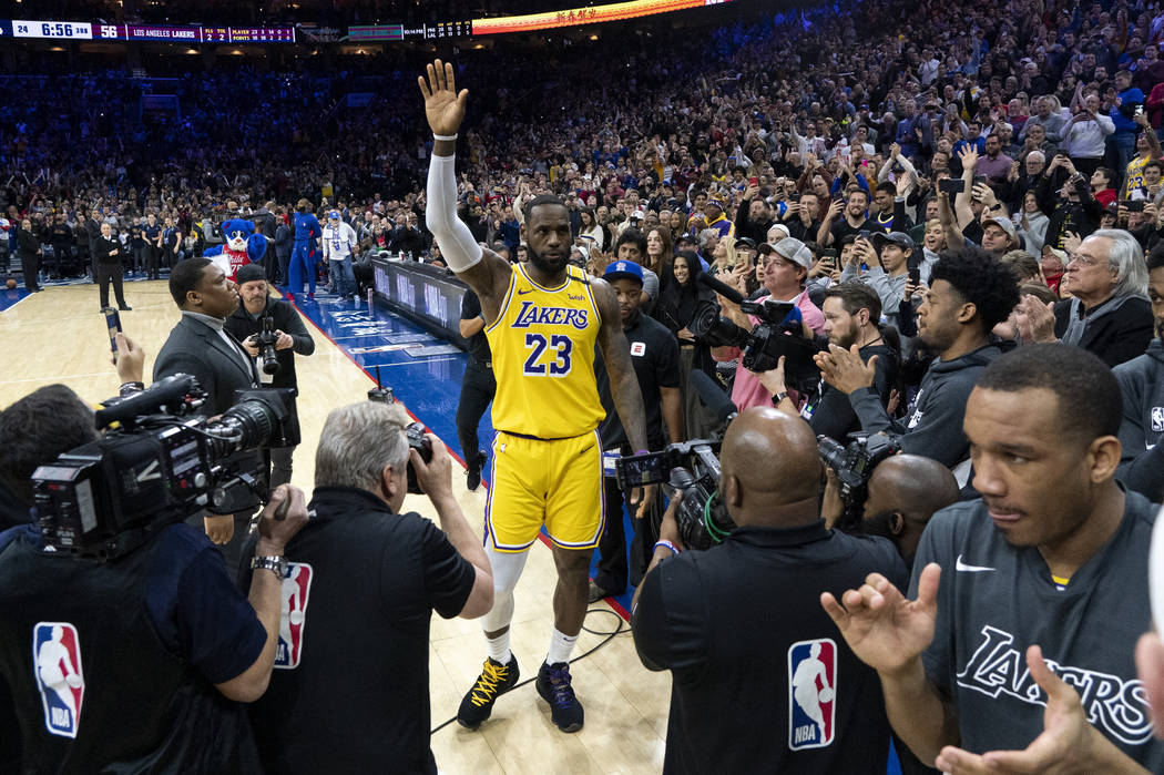 Los Angeles Lakers' LeBron James (23) reacts after moving to No. 3 on the NBA's career scoring ...