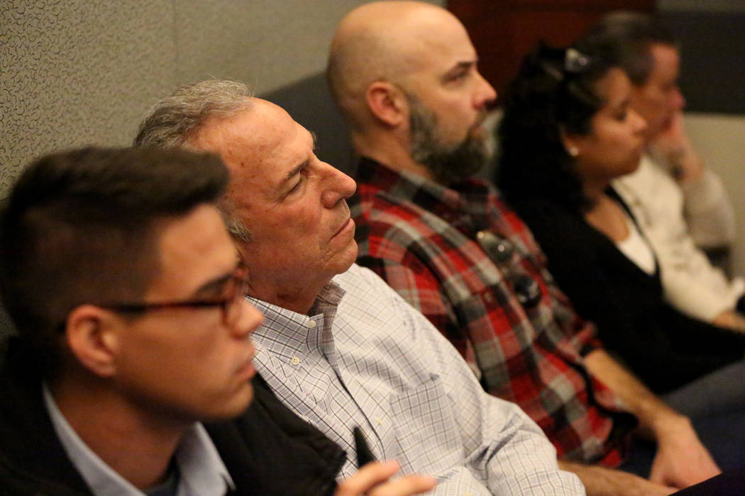Clark County District Attorney Steve Wolfson, center, listens to testimony during the trial of ...