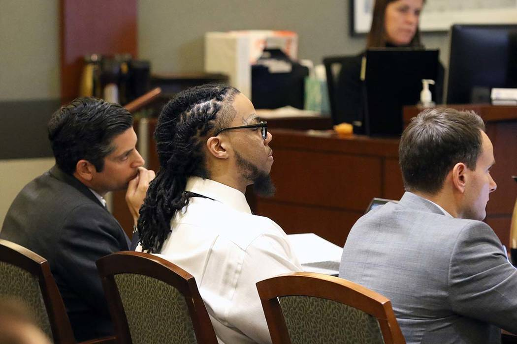 Ray Charles Brown, right, who faces the death penalty for fatally shooting Lee's Liquor clerk M ...