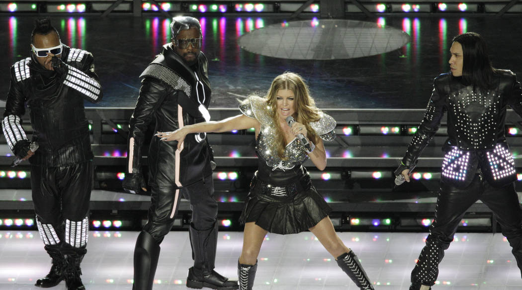 The Black Eyed Peas featuring Fergie, will.i.am, Taboo and apl.de.ap perform during halftime of ...