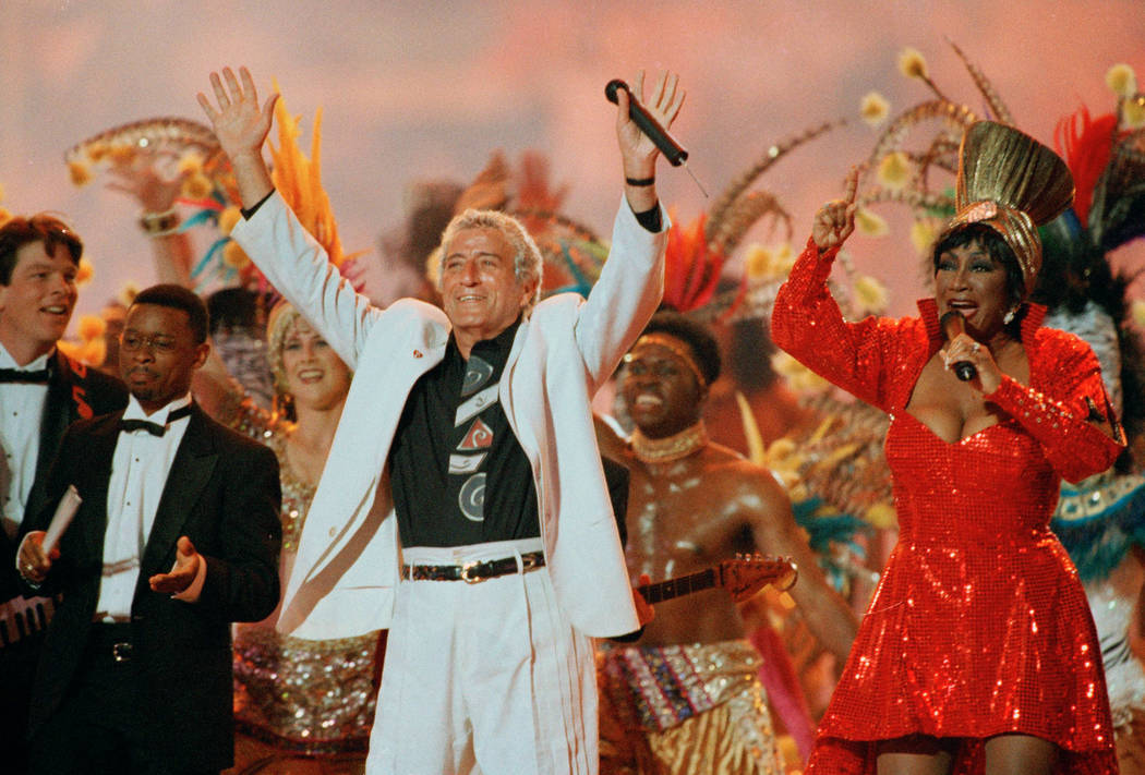 Singers Tony Bennett and Patti LaBelle entertain the crowd during halftime at Super Bowl XXIX, ...
