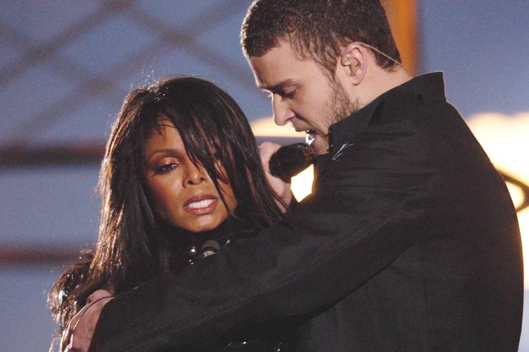 Justin Timberlake reaches across Janet Jackson during their performance just before he pulled o ...