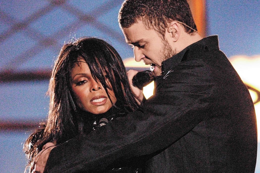 FILE*** Justin Timberlake reaches across Janet Jackson during their performancs just before he ...