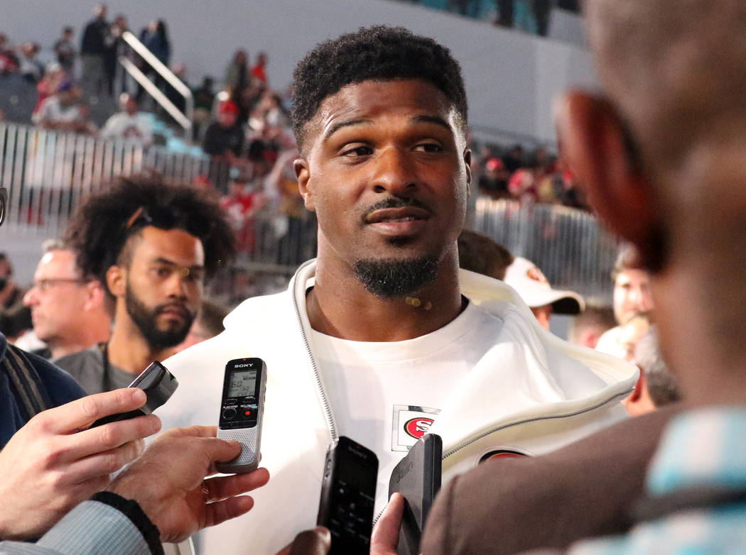 San Francisco 49ers defensive end Dee Ford takes questions from media during Super Bowl LIV Ope ...
