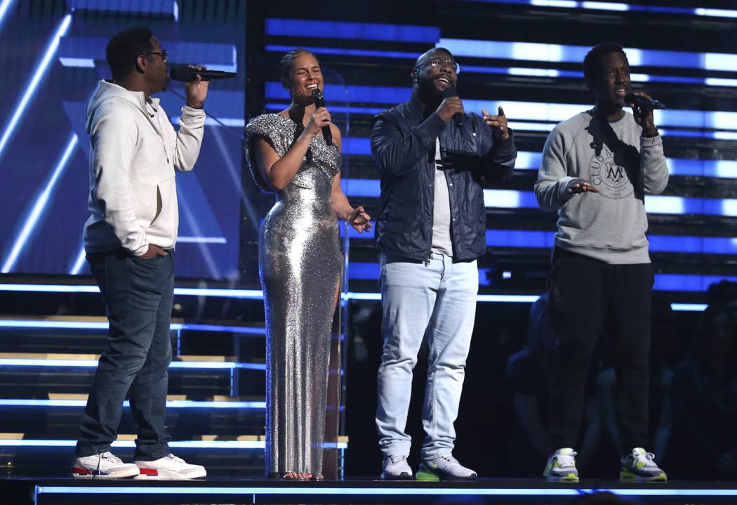 Nathan Morris, from left, Wanya Morris, Shawn Stockman, of Boyz II Men, and Alicia Keys ...