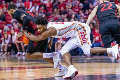 UNLV Rebels guard Bryce Hamilton (13, center) loses the ball late to San Diego State Aztecs for ...