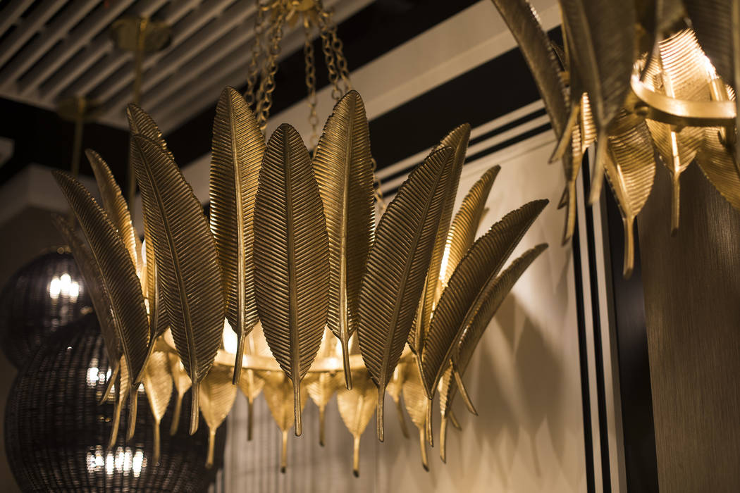 An example of feathers motif, a trend for the coming year, at the Corbett Lighting booth at the ...