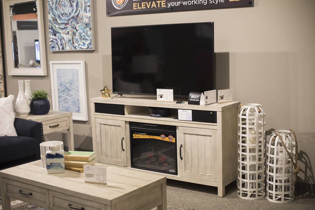 The Melissa unit that holds bluetooth speakers and an electric fireplace at the Twin Star Home ...