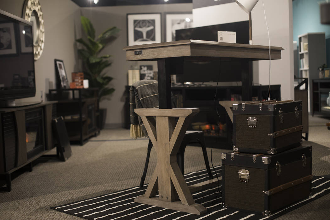 A desk with an adjustable height feature at the Twin Star Home booth at the Las Vegas Market in ...