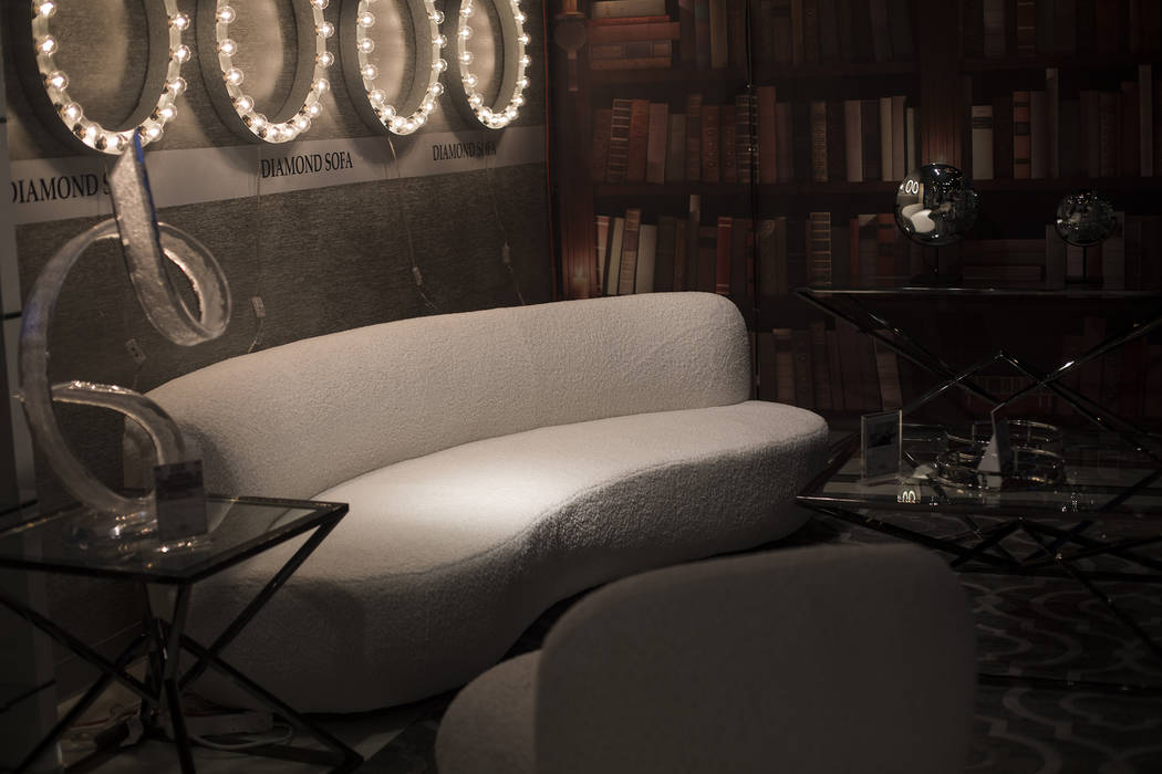The textured neutrals of the sofa at the Diamond Sofa booth is a trend for the coming year at t ...