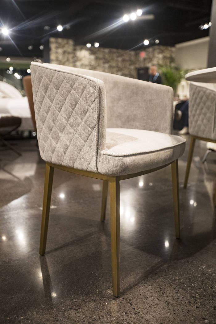 The chairÕs neutral textures shows a trend for the coming year at the Sunpan booth at the ...