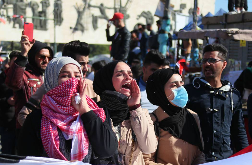 Anti-government protesters gather in Tahrir Square in Baghdad, Iraq, Sunday, Jan. 26, 2020. (AP ...