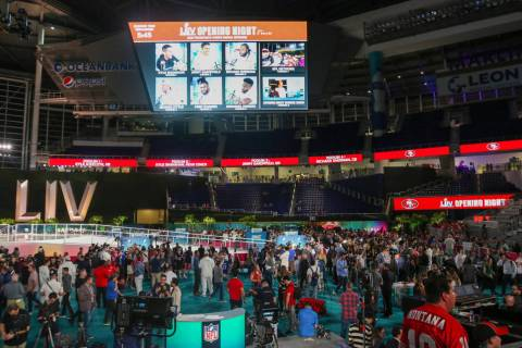 Fans and media attend Super Bowl LIV Opening Night in Marlins Park in Miami, Fla., Monday, Jan. ...