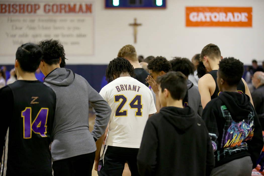 Bishop Gorman and Durango players, including Durango guard Keshon Gilbert wearing a Kobe Bryant ...