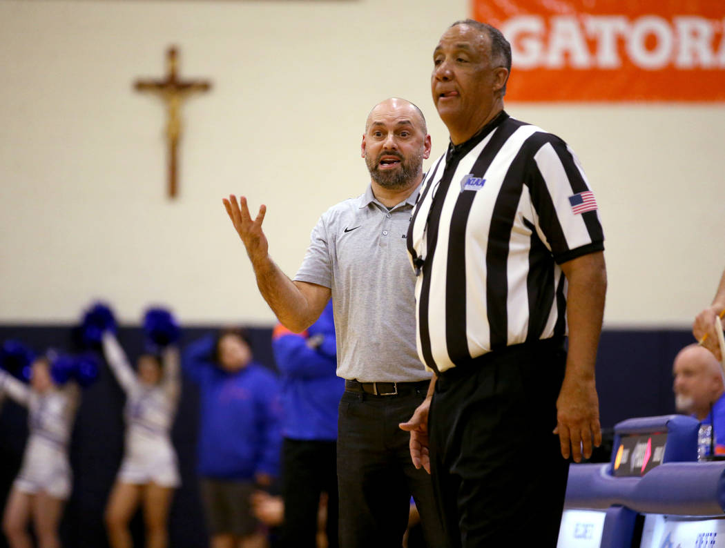 Durango coach in the Chad Beeten argues a call in the second quarter of a basketball game agai ...