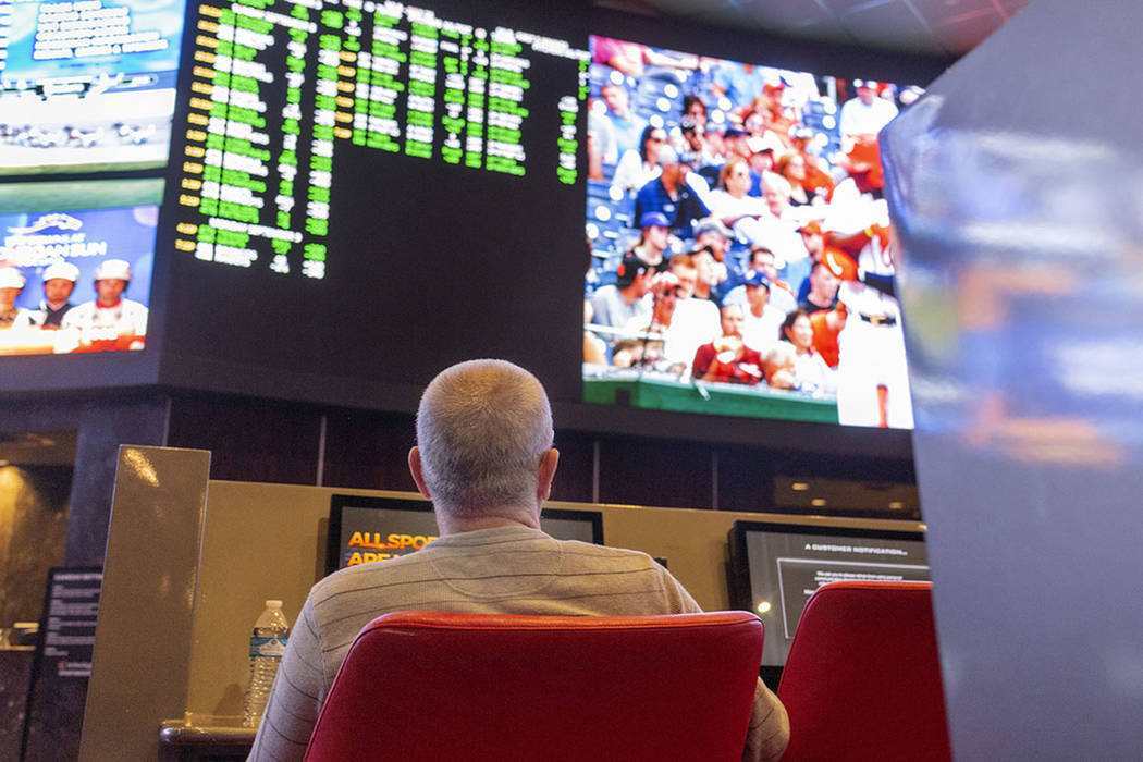 Bettors watch live sports at the sportsbook at the Palms in Las Vegas, Thursday, July 25, 2019. ...