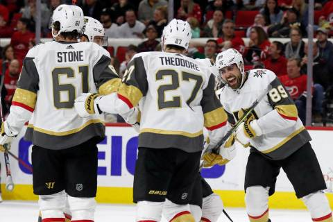 Vegas Golden Knights right wing Alex Tuch (89) celebrates with defenseman Shea Theodore (27) an ...