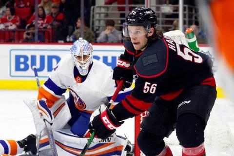 Carolina Hurricanes' Erik Haula (56) passes the puck as New York Islanders goaltender Thomas Gr ...