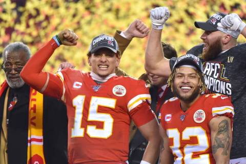 Kansas City Chiefs' Patrick Mahomes (15), Travis Kelce and Tyrann Mathieu (32) celebrate after ...