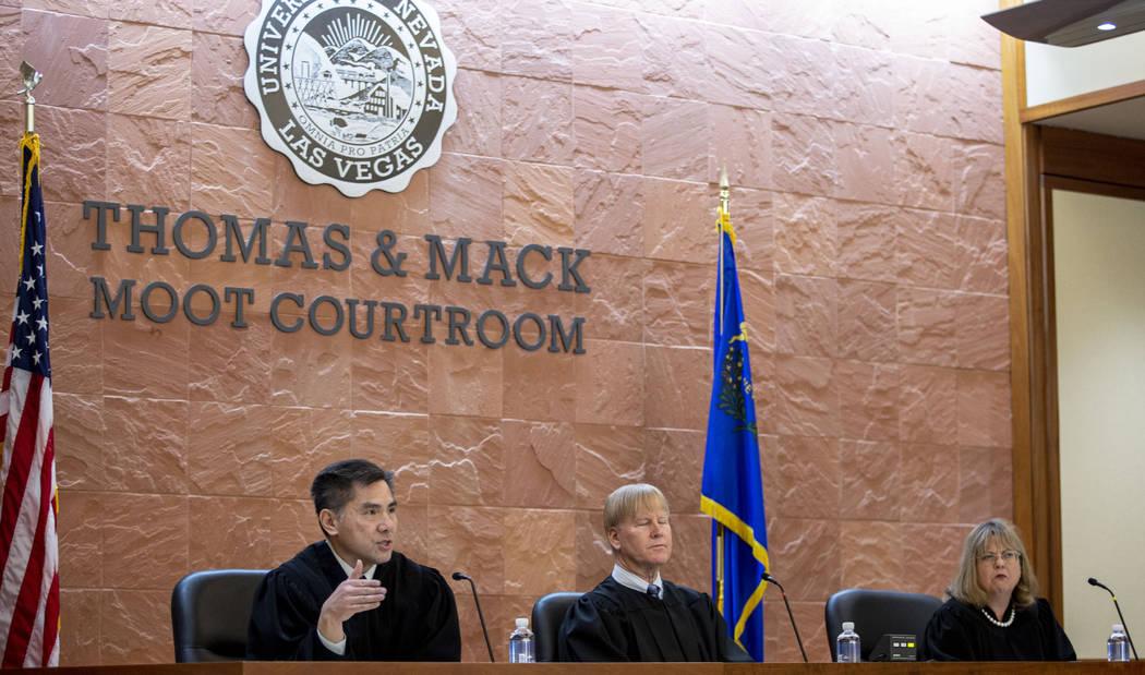 Judge Jerry Tao, left, Chief Judge MichaelGibbons, center, andJudge Bonnie Bulla, speak wit ...