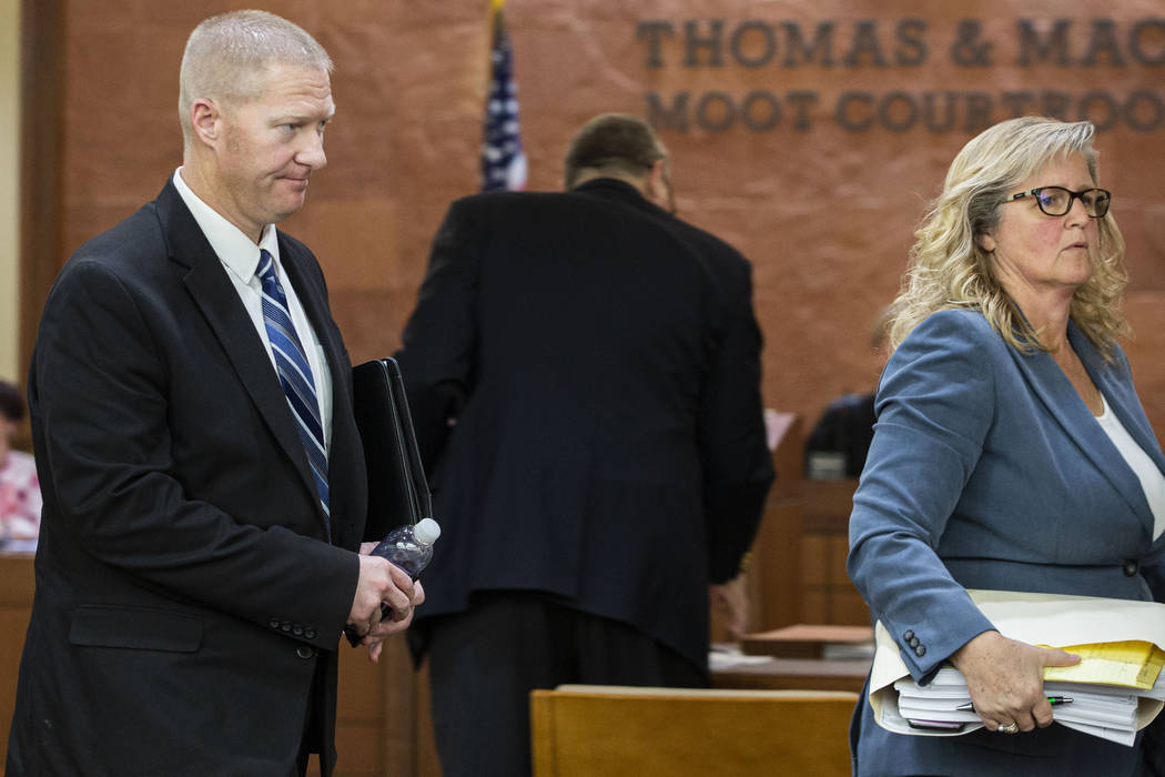 Former Henderson police officer Jared Spangler, left, and attorney Lisa Anderson leave the Thom ...