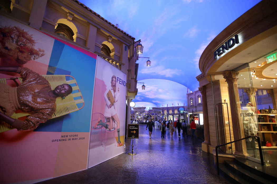 A new Fendi store under construction, left, across from a Fendi Pop-up Boutique inside the Foru ...