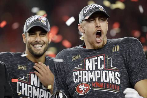 San Francisco 49ers quarterback Jimmy Garoppolo, left, and tight end George Kittle celebrate af ...