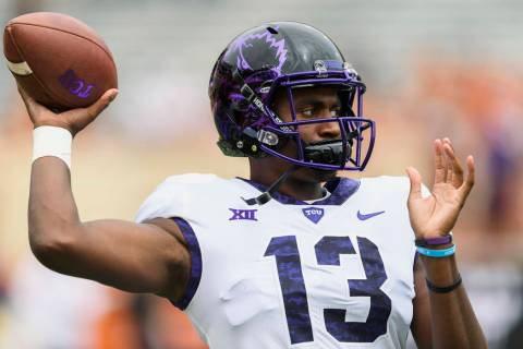 TCU quarterback Justin Rogers (13) warms up before a game against Longhorns. Saturday, Septembe ...