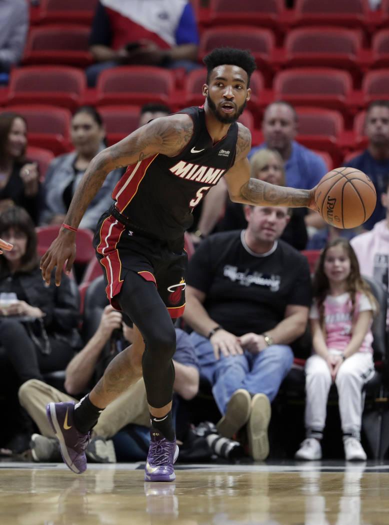 Miami Heat forward Derrick Jones Jr. dribbles the ball during the first half of an NBA basketba ...