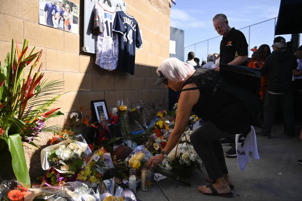 Judy Pratt lays flowers down at a memorial for John Altobelli, the late head coach of Orange Co ...