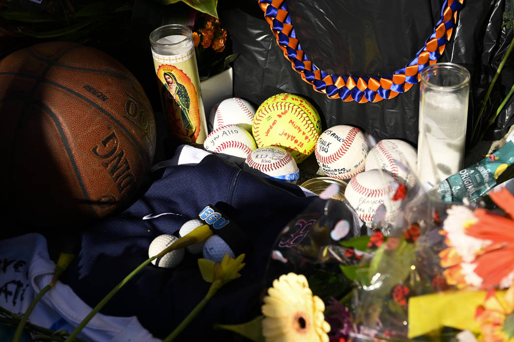 Baseballs sit in a memorial made for John Altobelli, the late head coach of Orange Coast Colleg ...