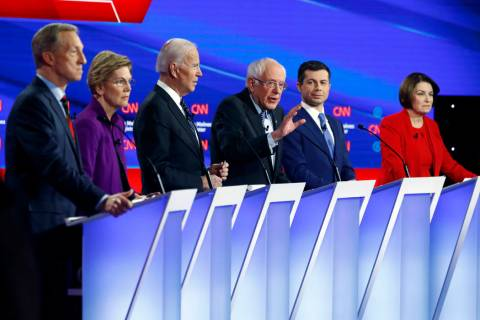 Democratic presidential candidate Sen. Bernie Sanders, I-Vt.,, center, speaks as fellow candida ...
