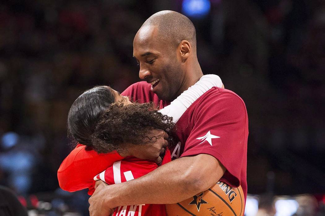 In a Feb. 14, 2016, file photo, Los Angeles Lakers Kobe Bryant (24) hugs his daughter Gianna on ...