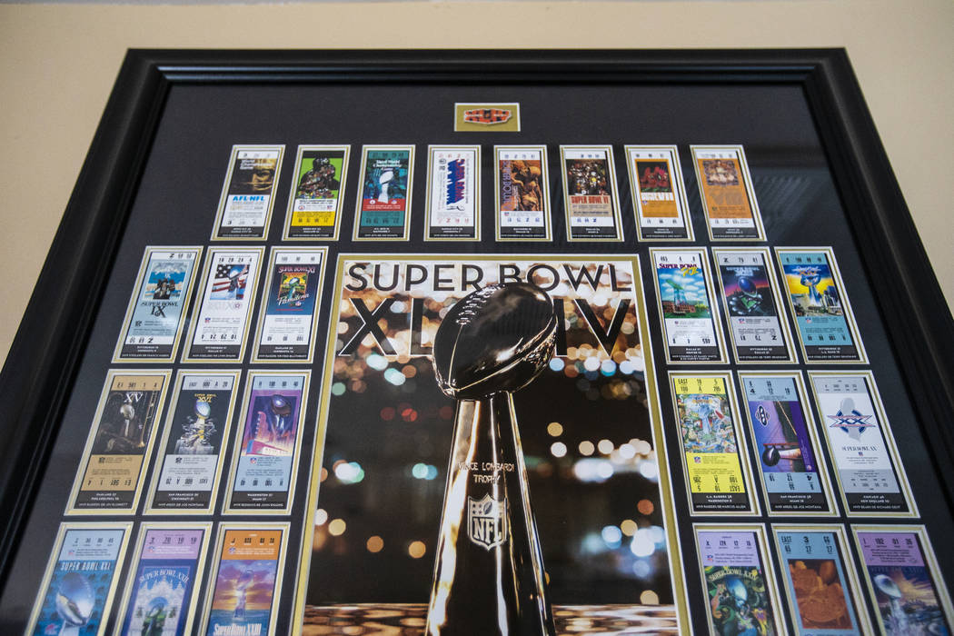 Framed Super Bowl tickets accumulated over a lifetime of covering the NFL championship game han ...
