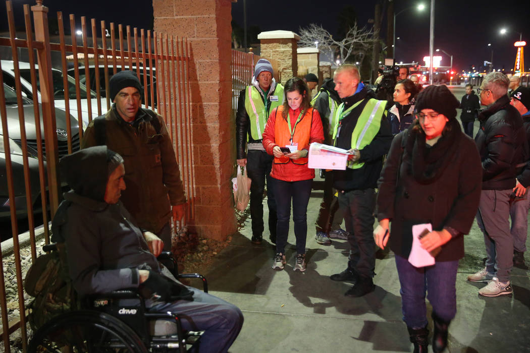 SafeNest CEO Liz Ortenburger, center, uses an app to survey and count the homeless population f ...