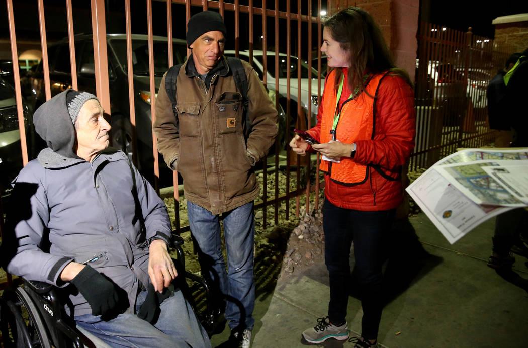 SafeNest CEO Liz Ortenburger uses an app to survey Harry Southworth, 58, center, as Nick Scioli ...