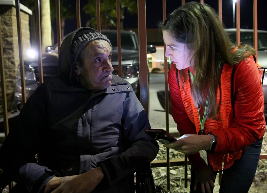 SafeNest CEO Liz Ortenburger uses an app to survey Nick Scioli, 64, on Las Vegas Boulevard near ...