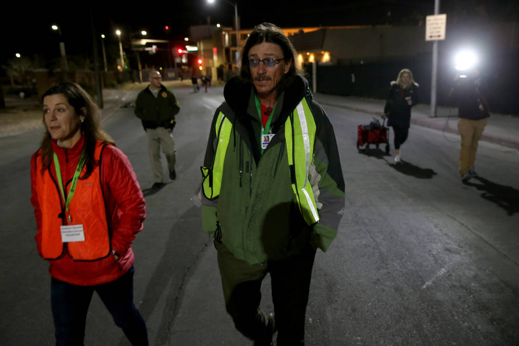 SafeNest CEO Liz Ortenburger and homeless count volunteer Mark Chadwick on Foremaster Lane in d ...