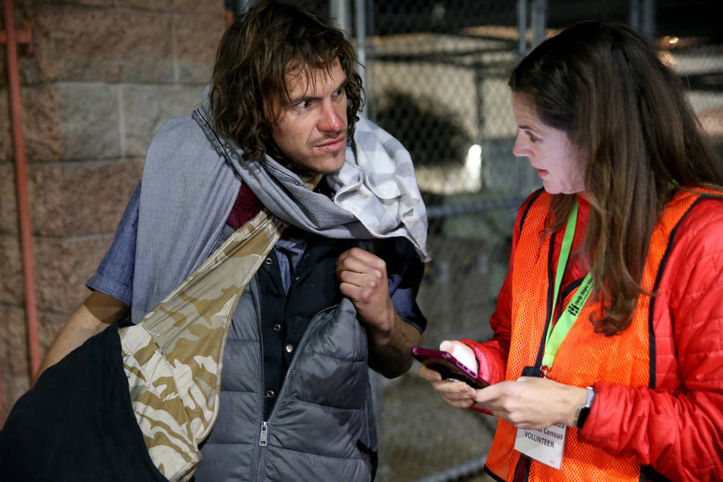 SafeNest CEO Liz Ortenburger uses an app to survey Nickolas Rufer, 28, on Foremaster Lane in do ...